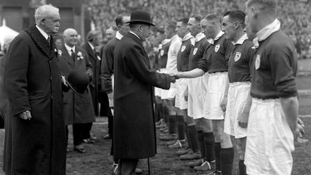King George V shakes hands with the Arsenal team before the start of the 1930 FA Cup final