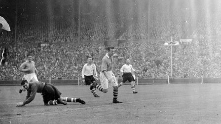 Liverpool goalkeeper Cyril Sidlow is well beaten as Arsenal's Reg Lewis (second right) puts the ball
