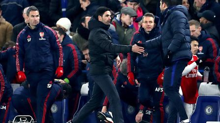 Arsenal manager Mikel Arteta (left) shakes hands with Chelsea manager Frank Lampard (right) after th