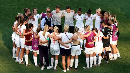 England coach Phil Neville consoles his team after the final whistle during the FIFA Women's World C