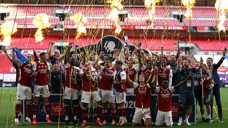 Arsenal celebrate their victory with the FA Cup trophy after the Heads Up FA Cup final match at Wemb