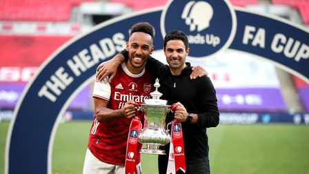 Arsenal manager Mikel Arteta (right) and Pierre-Emerick Aubameyang celebrate with the trophy after w