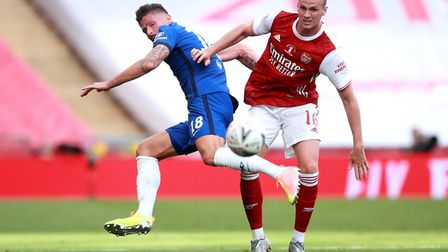 Chelsea's Olivier Giroud (left) and Arsenal's Rob Holding battle for the ball during the Heads Up FA