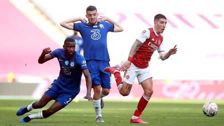 Arsenal's Hector Bellerin (right) and Chelsea's Antonio Rudiger battle for the ball during the Heads