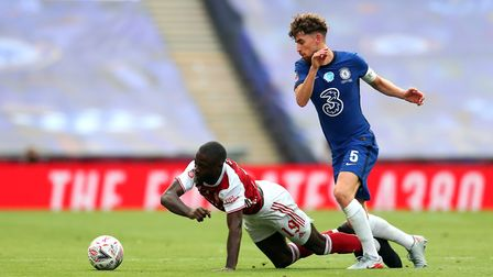 Arsenal's Nicolas Pepe (left) and Chelsea's Jorginho battle for the ball during the Heads Up FA Cup