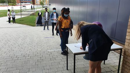 A very different year... Ark Elvin pupils queue social distance-style to get their GCSE results. Pic