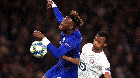 Chelsea's Tammy Abraham (left) and Lille's Magalhaes Gabriel battle for the ball during the UEFA Cha