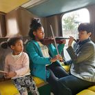 Kids trying out instruments on the Musical Bus at Willesden Sports Centre until Sunday. Picture: Lyc
