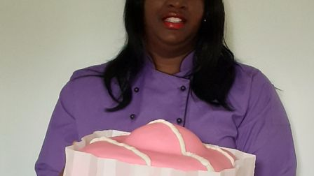 Creative cake artist Cynthia Akinsanya with an example of the giant fondant fancies. Picture: Jemima
