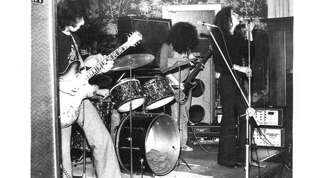 Band photo taken at The Angel pub. Left to right, Frank Martines (guitar), Tom Kelly (drummer), Paul