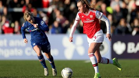 Arsenal's Jill Roord in action with Chelsea's Erin Cuthbert during the Women's Super League match at
