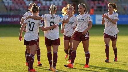 Arsenal's Beth Mead (centre) celebrates scoring her side's fourth goal with team-mates of the game d