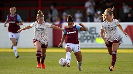 West Ham United's Maz Pacheco (centre) battles for the ball with Arsenal's Kim Little (left) and Lia