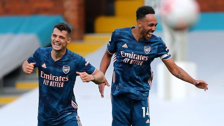 Arsenal's Pierre-Emerick Aubameyang (right) celebrates with Granit Xhaka after scoring his side's th