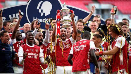 Arsenal's Pierre-Emerick Aubameyang (centre) and team-mates celebrate with the trophy after winning