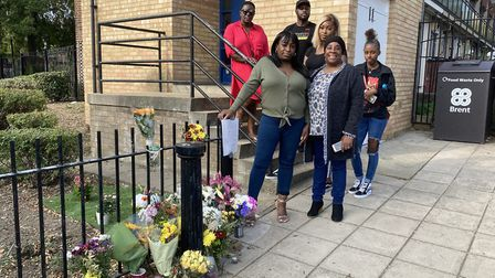 Anthony Higgins' family, headed by sisters Claudette Brown and Angela Smith, next to his memorial. P