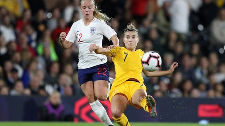 England Women's Beth Mead and Australia Women's Steph Catley (right) battle for the ball during the
