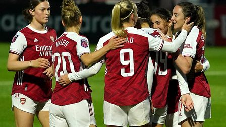Arsenal's Lisa Evans (right) celebrates scoring her side's fourth goal of the game and hat-trick dur