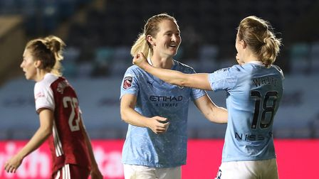 Manchester City's Sam Mewis (centre) celebrates scoring her teams second goal against Arsenal with E