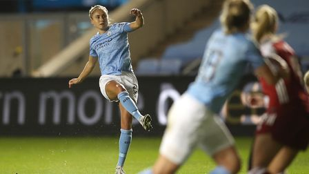 Manchester City's Steph Houghton scores her team's first goal against Arsenal