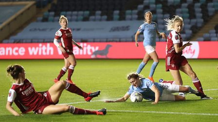 Manchester City's Ellen White battles for the ball with Arsenal's Leah Williamson (right) and Vikkto