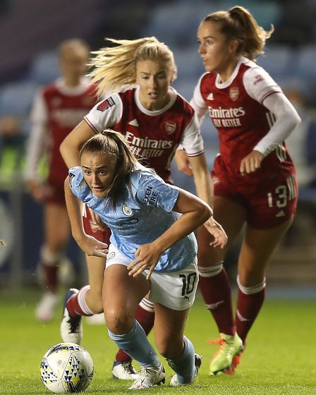 Manchester City's Georgia Stanway battles for the ball with Arsenal's Leah Williamson