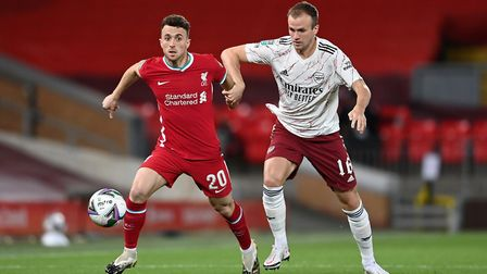 Liverpool's Diogo Jota (left) and Arsenal's Rob Holding battle for the ball