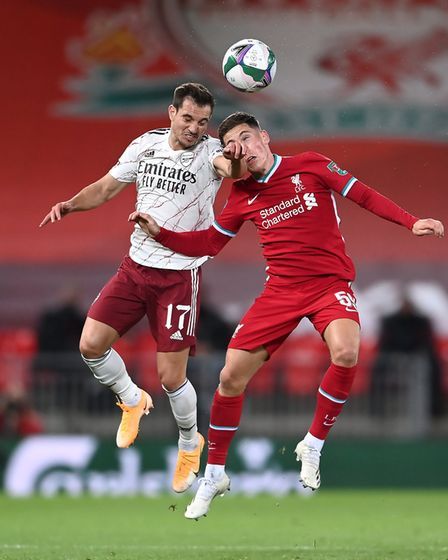 Arsenal's Cedric Soares (left) and Liverpool's Harry Wilson battle for the ball
