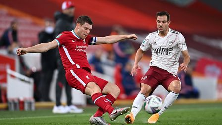 Liverpool's James Milner (left) and Arsenal's Cedric Soares in action during the Carabao Cup fourth