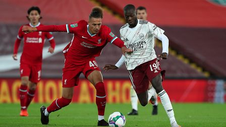 Liverpool's Rhys Williams (left) and Arsenal's Nicolas Pepe battle for the ball