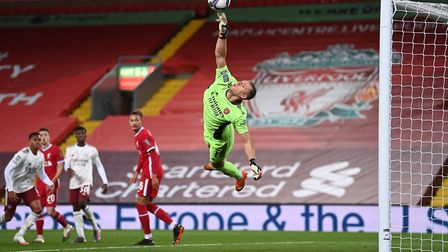 Arsenal goalkeeper Bernd Leno makes a save during the Carabao Cup fourth round match at Anfield