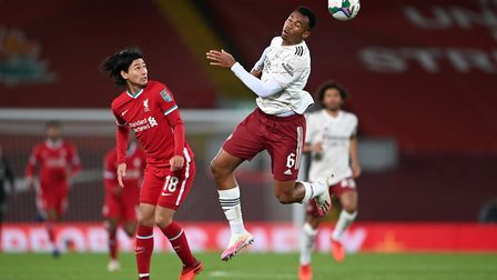 Liverpool's Takumi Minamino (left) and Arsenal's Gabriel Magalhaes in action during the Carabao Cup