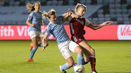 Manchester City's Ellen White battles for the ball with Arsenal's Leah Williamson during the Vitalit