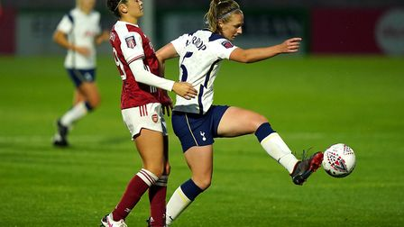 Arsenal's Caitlin Foord (left) and Tottenham Hotspur's Kerys Harrop battle for the ball during the B