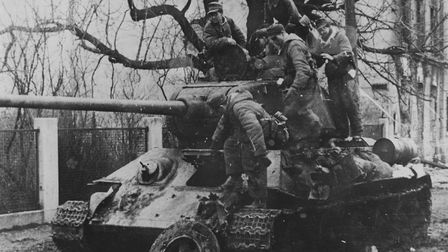 German soldiers with a crippled Russian tank in the city, 1945. Photo: Getty