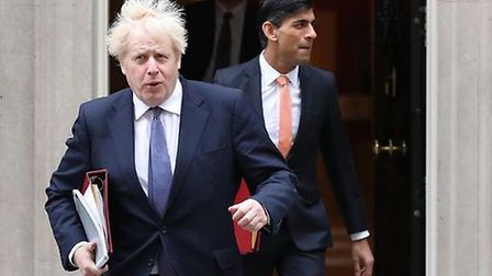 Prime Minister Boris Johnson (left) and Chancellor of the Exchequer Rishi Sunak leave 10 Downing Str