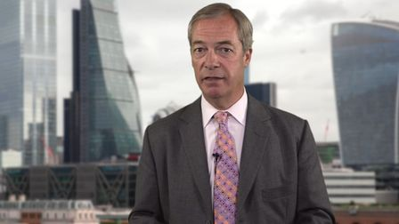 Nigel Farage stands in front of an image of city of London skyscrapers in a video advert for his Fortune & Freedom...