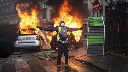 A gilets jaunes (yellow vest) protestor on the streets of Paris after discontent over taxes and risi