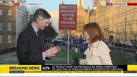 Steve Bray's placard appears during an interview with Jacob Rees-Mogg by Sky's Kay Burley. Picture: