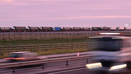 Lorries stand parked at Manston airport near Ramsgate, south east England as they wait to take part