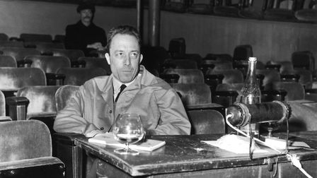 """French writer Albert Camus during a rehearsal of """"Les Possedes"""" at the Parisian Theatre Antoine, in"""