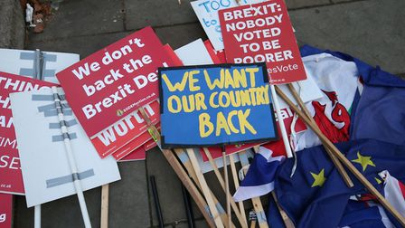Brexit protestors placards lay on the ground near Parliament. Photograph: Jonathan Brady/PA Wire.