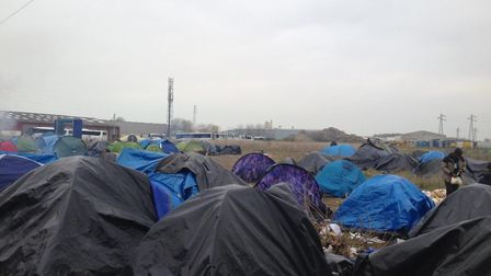 Refugees spending winter in the migrant camp on the outskirts of Calais. Photo: Joe Wallen.