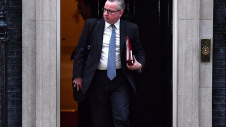 Britain's Environment, Food and Rural Affairs Secretary Michael Gove leaves after an emergency cabin