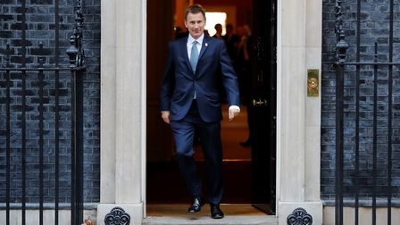 Britain's Foreign Secretary Jeremy Hunt leaves after attending the weekly meeting of the cabinet at
