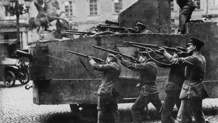 circa 1919: Soldiers firing on loyalist officers in Berlin Castle from an armoured vehicle, during