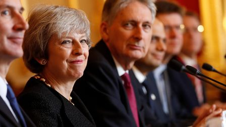 Prime Minister Theresa May (C) sits with members of her cabinet including chancellor Phillip Hammond