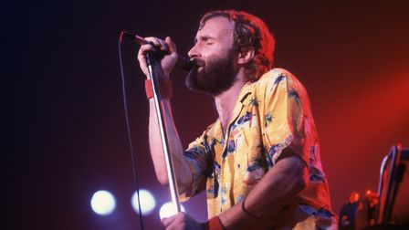 British Pop and Rock musician Phil Collins of the group Genesis performs onstage at the Rosemont Hor
