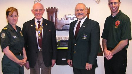The defibrillator was presented by Kim Morrissey from GWAS, (community response manager) to Jim Perr