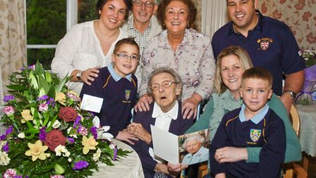 Kathleen Harper with her family on her 100th birthday.